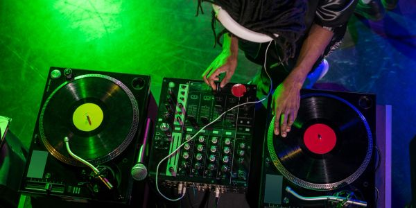 DJ using a mixing console