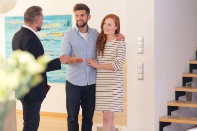 Couple talking to a mortgage broker in a house