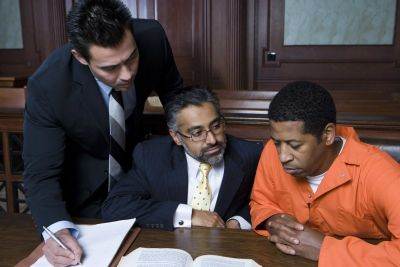 Criminal Defense Attorney advising client in custody on Felony case in Court during Trial