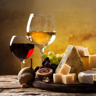 cheese on table with wine glasses