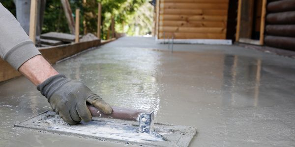 Exterior concrete floor being prepped for concrete polishing