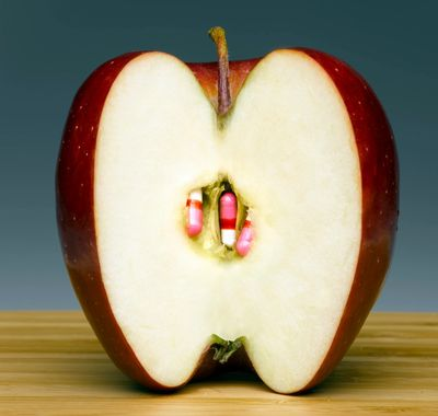 Nutritional supplements inside of an apple.