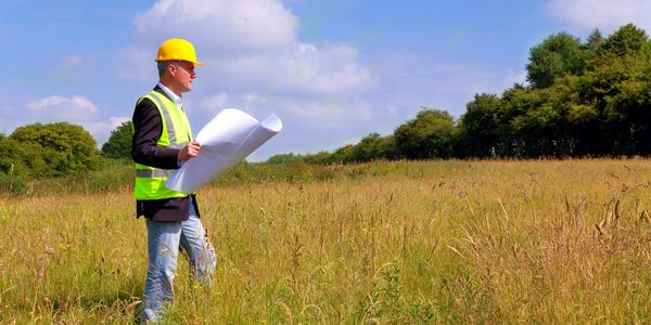 Builder evaluating a new home site