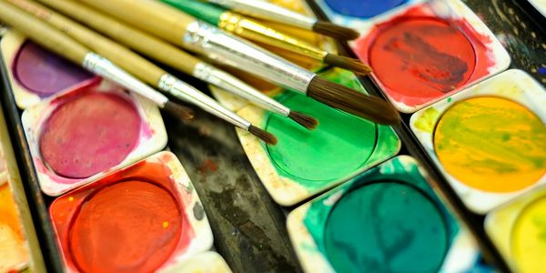watercolour paints and paint brushes for children's art class in Edinburgh