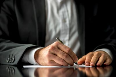 Man writing a document