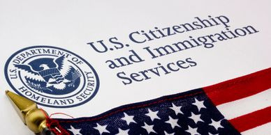 USCIS logo with American flag.