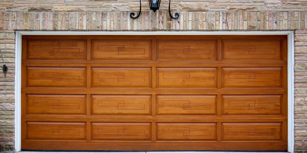 Beautiful look of a wood garage door with the long lasting benefits of a steel garage door.