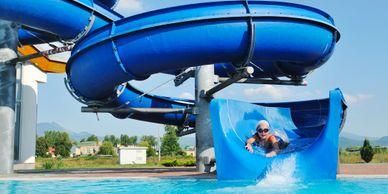 Child coming down water slide.