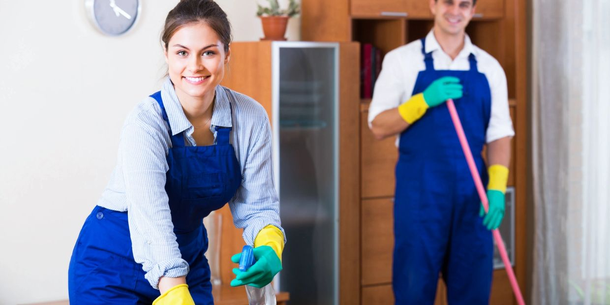 A couple of chipper employees providing janitorial cleaning services in Bakersfield, CA