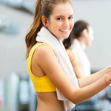 Marina Fitness Monthly Membership  a smiling girl with a ponytail and a towel round her neck