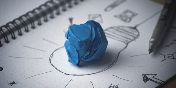 ball of paper over notebook