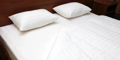 Clean white linen on a bed