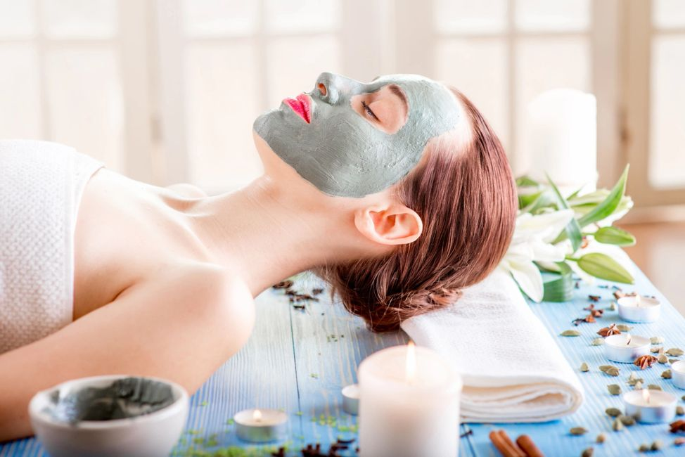 woman with mask on face spa
