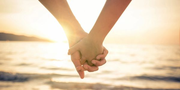 Couple holding hands on the Beach. Ocean City, MD | Beach Life | Sunset Island