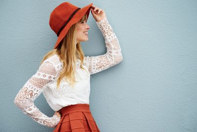 happy customer with white lace blouse, red linen skirt and red hat