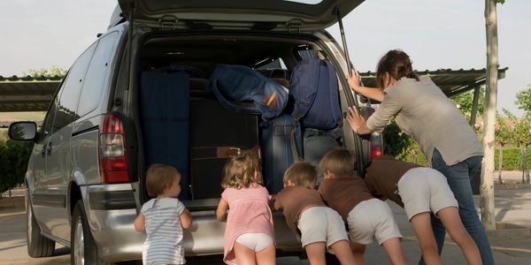 Family working together to get the van back home. It ran out of gas because their credit card declined.