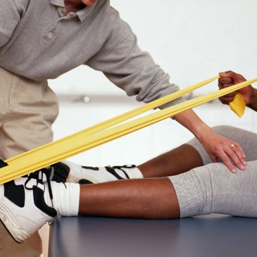 a patient using a theraband for foot exercises, he is plantarflexing the foot.