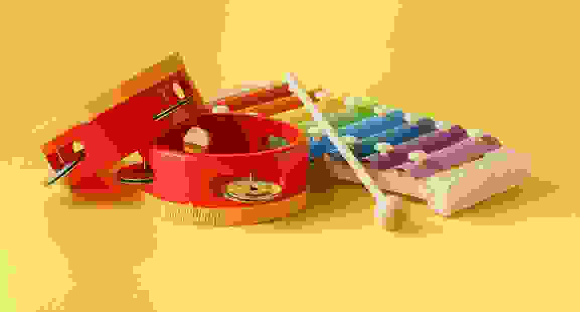 A toy Xylophone and two tambourines ready for music with infants
