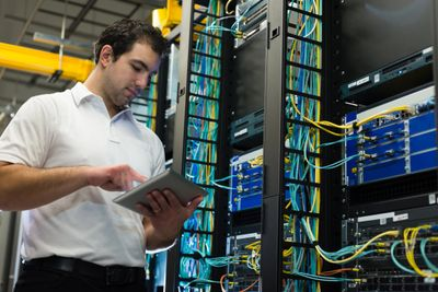 IT Consultant trouble shooting network infrastructure at the main distribution frame