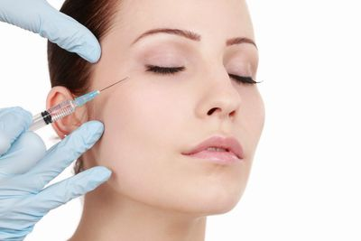 Women having anti-ageing injections.