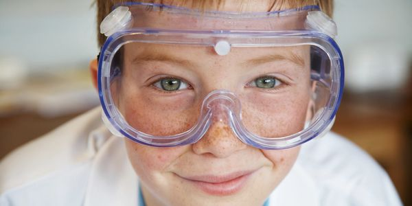 A boy wearing lab goggles.