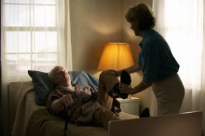 Image representing More Services, shows physical therapist helping a patient.