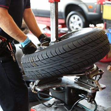 Mechanic removes car tire