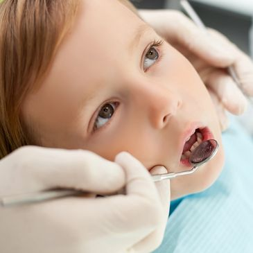 Young child having a dental exam