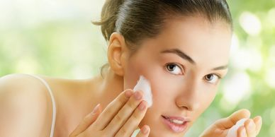 benefits of microdermabrasion woman washing her face