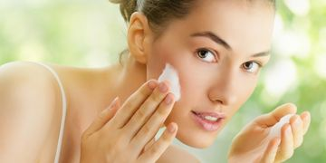 Woman caring for her sensitive skin