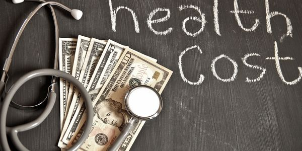 "Says ""health care cost"" and shows a stethoscope with cash under it."