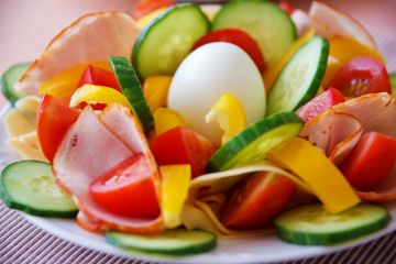 A healthy and colorful salad with cucumbers and tomatoes.