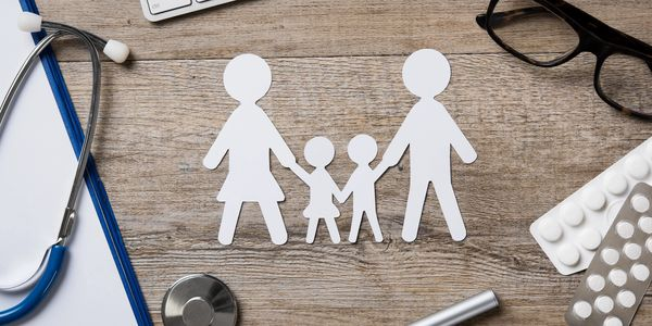 a paper cut out family on a wood background www.glassbottomtours.com