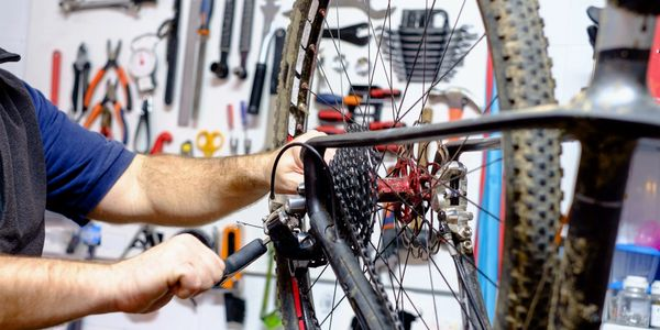 Bicycle repair being performed