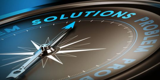 Picture of a compass pointing at the word solution.