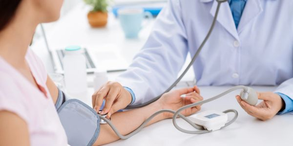 Measuring blood pressure and taking care of patient