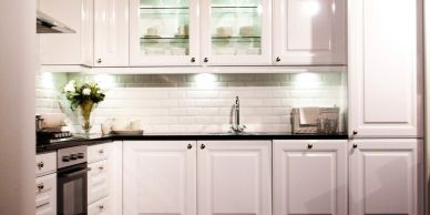 white kitchen cabinets and sink
