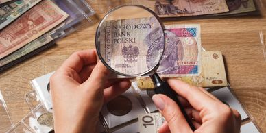 Magnifying glass looking at paper money