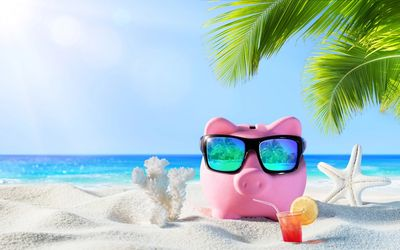 Piggy bank on beach. Weekend and evening online therapy available with therapist Jennifer Hillier.