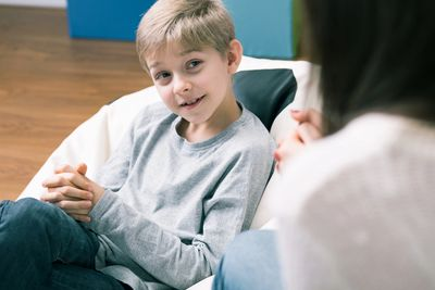 child speaking to counselor
