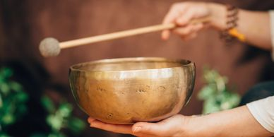 Singing bowl with wooden striker