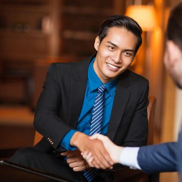 Man shaking hands while discussing Business Development