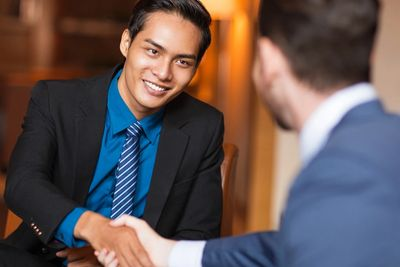 Businessman shaking hand of consultant