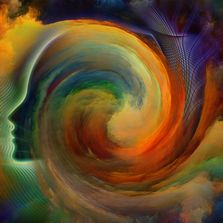 A swirling image of a human head in rainbow colours