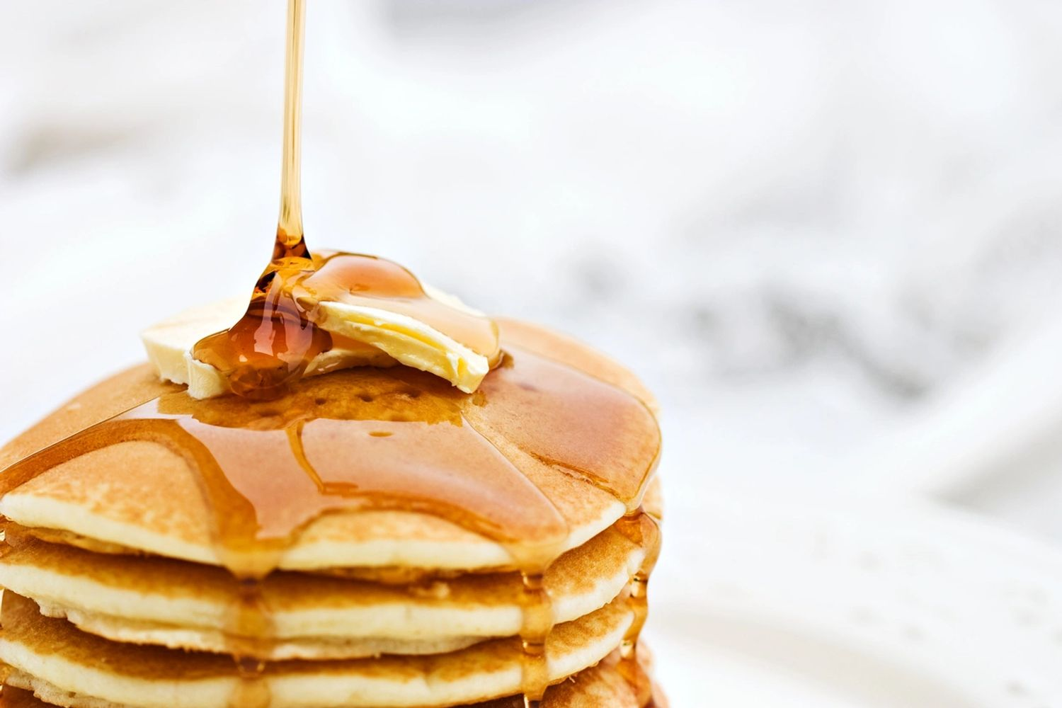 Golden pancakes and Rodgers Maple Syrup.
