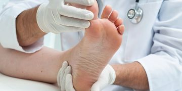 doctor examing foot