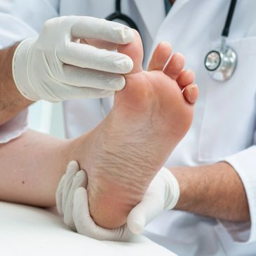 Doctor analysing patient's foot