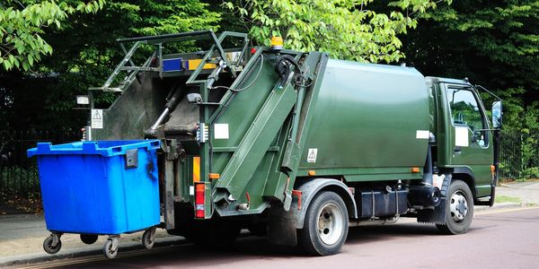 recycling bin and garbage truck