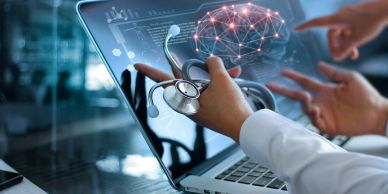 Providers looking at computer screen of brain EKG