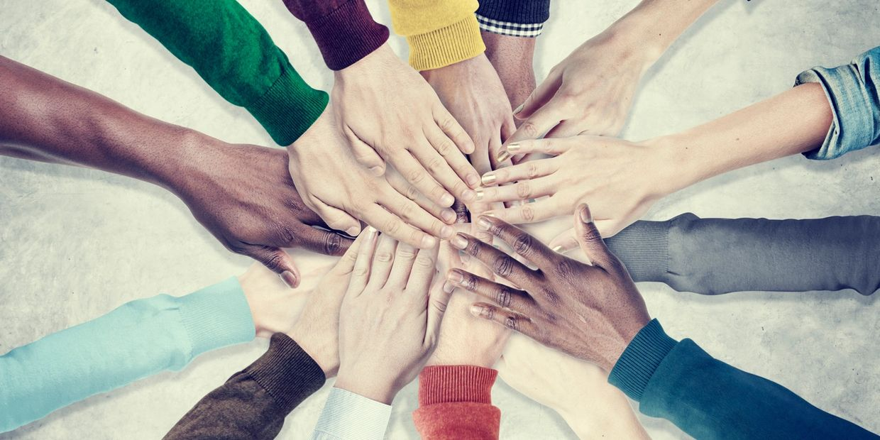 A group of diverse hands united in support